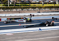Feb 11, 2019; Pomona, CA, USA; NHRA top fuel driver Steve Torrence (far) races alongside Mike Salinas during the Winternationals at Auto Club Raceway at Pomona. Mandatory Credit: Mark J. Rebilas-USA TODAY Sports