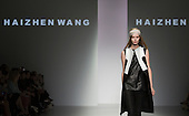 17 September 2013, London, UK. A model walks the runway at the Haizhen Wang fashion show during London Fashion Week at Somerset House. Photo: Bettina Strenske
