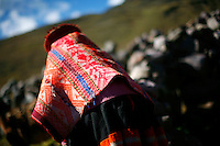 An indigenous woman walks through in the Lares Valley village of Quisuarana, Peru, on May 16, 2008. The Lares Valley contains crystal-clear lakes and unspoiled mountain vistas. The Quechua, indigenous Inca people of Southern Peru with their small villages dotting the region, also populates the network of valleys.