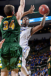 SIOUX FALLS, SD - MARCH 7:  Michael Calder #12 of Fort Wayne takes a jump shot over defender Chris Kading #34 of North Dakota State in the 2016 Summit League Tournament.  (Photo by Dave Eggen/Inertia)