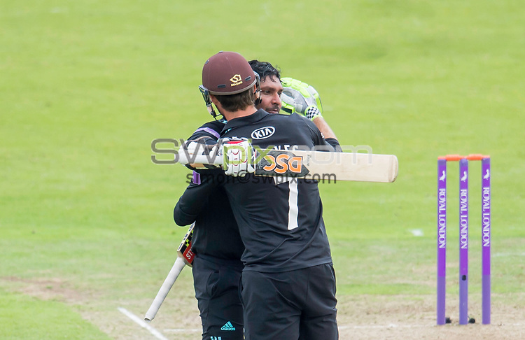 Picture by Allan McKenzie/SWpix.com - 13/06/2017 - Cricket - Royal London One-Day Cup - Yorkshire County Cricket Club v Surrey County Cricket Club - Headingley Cricket Ground, Leeds, England - Kumar Sangakkara is congratulated by Ben Foakes on his century against Yorkshire.