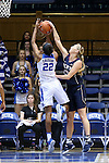 13 November 2016: Penn's Sydney Stipanovich (right) blocks a shot by Duke's Oderah Chidom (22). The Duke University Blue Devils hosted the University of Pennsylvania Quakers at Cameron Indoor Stadium in Durham, North Carolina in a 2016-17 NCAA Division I Women's Basketball game. Duke defeated Penn 68-55.