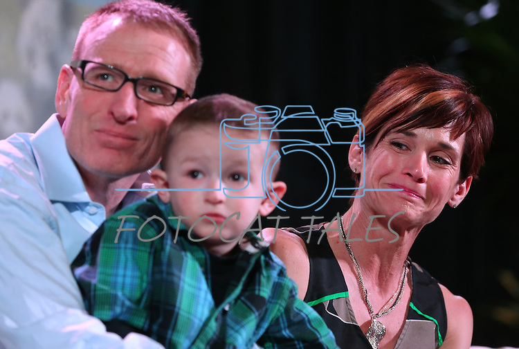 An emotional Kristi Young and her husband Scott watch a video about their 3-year-old son Isaac at the Make-A-Wish Waffles & Wishes event at the Atlantis Casino Resort Spa in Reno, Nev., on Tuesday, March 26, 2013. Isaac is fighting liver cancer and was granted a wish of a road trip to California during the 30th anniversary event..Photo by Cathleen Allison