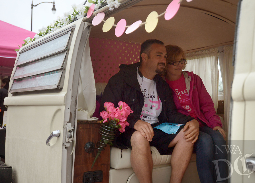 NWA Democrat-Gazette/BEN GOFF @NWABENGOFF<br /> Jeff Maxwell and wife Shandra Maxwell, a breast cancer survivor, of Siloam Springs, pose for pictures in the Das VW FotoFace (CQ) mobile photo booth Saturday, April 22, 2017, during the annual Susan G. Komen Ozark Race for the Cure at Pinnacle Hills Promenade in Rogers. The photo booth, a 1969 Volkswagen bus, is owned and operated by Nancy Hairston.
