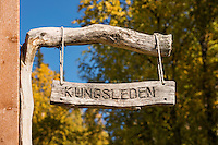 Wooden Kungsleden sign at STF Aktse hut, kungsleden trail, Lapland, Sweden