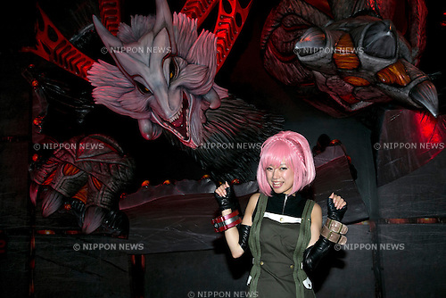 An exhibitor poses for the camera at Tokyo Game Show,  September 20, 2013. The Tokyo Game Show one of the world's biggest trade show for video game developers brings exhibitors from 33 different countries and regions, 352 companies and organizations, opens from September 19 to 22 at the International Convention Complex Makuhari Messe in Chiba. (Photo by Rodrigo Reyes Marin/AFLO)