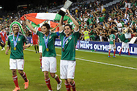 Mexico players parade the trophy around the stadium... Mexico defeated Honduras 2-1 after extra time to win the CONCACAF Olympic qualifying trophy at LIVESTRONG Sporting Park, Kansas City, Kansas.