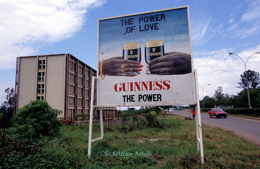 A Guiness advert in central Kigali, Rwanda riddled with  bullets from fighting in the streets as the Tutsi army came in to Kigali following the genocide in 1994.
