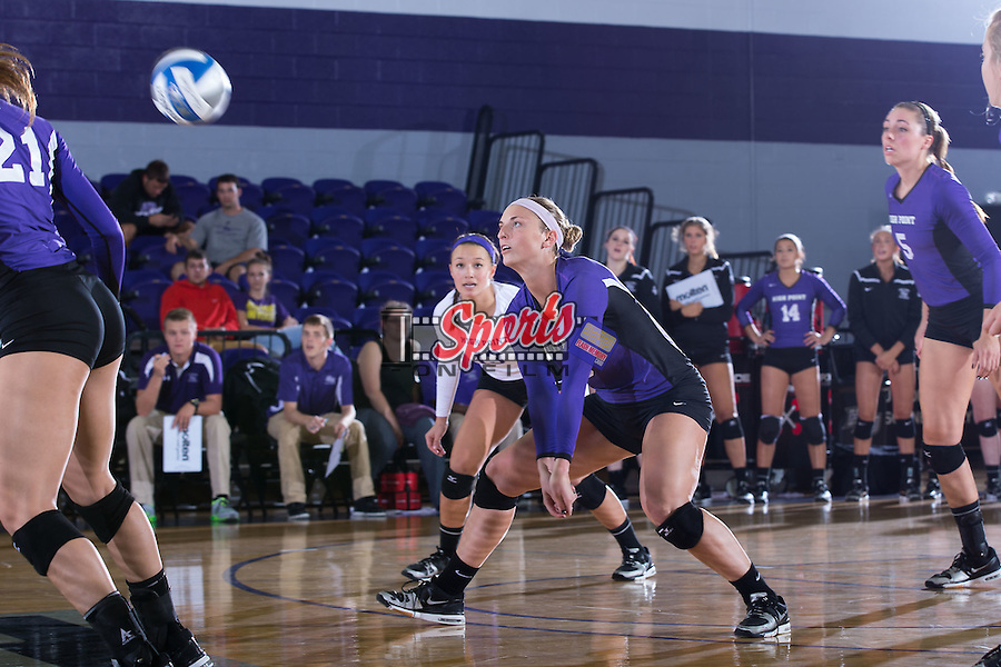 Megan Kennedy (6) of the High Point Panthers digs the ball against the UNC Greensboro Spartans at Millis Athletic Center on September 16, 2014 in High Point, North Carolina.  The Panthers defeated the Spartans 3-0.   (Brian Westerholt/Sports On Film)