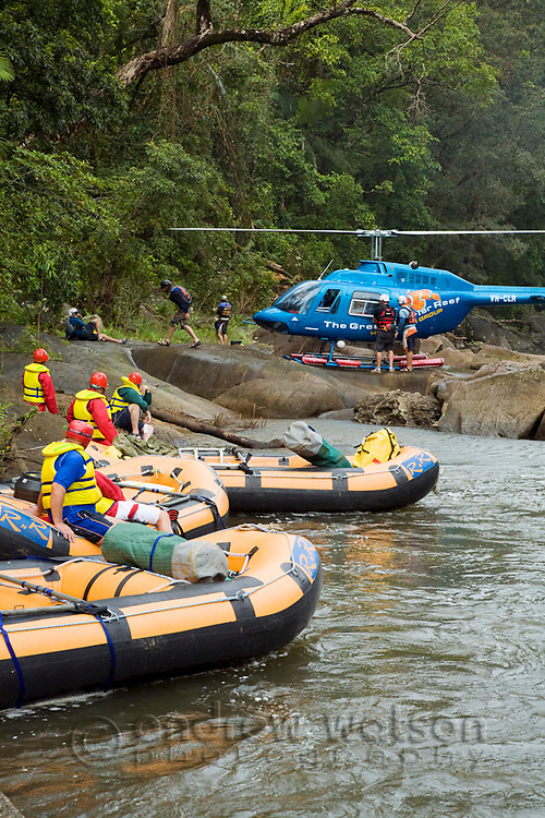 Helicopter dropping off people and equipment for a heli-rafting adventure on the North Johnstone River.  Wooroonoonan National Park, Queensland, Australia