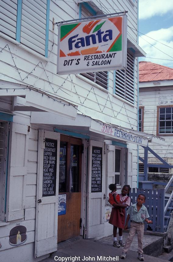 Belizian children outside Dit's Restuarant in downtown Belize City, Belize