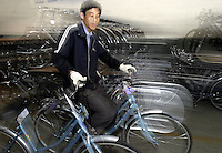 A worker transports finshed bicycles in a warehouse at the Shanghai Forever Bicycle Factory (SFBF) in Shanghai, China. Despite the government's efforts to encourage automobile ownership in recent years, the bicycle remains the most popular mode of transportation for China's masses. The SFBF, it's products once a must have and a symbol of status for every Chinese family, are now supplying bicycles to countries around the world. It has seen it's sales increase 59% percent in the past year to 876 million yuan (euro 89.36 million)..21-APR-04