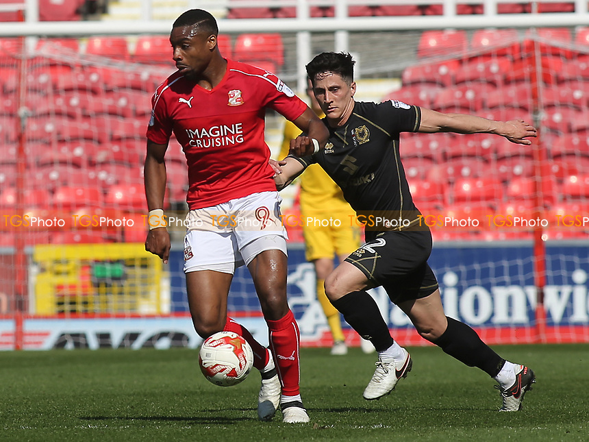 George B Williams of MK Dons keeps a close eye on Swindon's Jon Obika during Swindon Town vs MK Dons, Sky Bet EFL League 1 Football at the County Ground on 8th April 2017