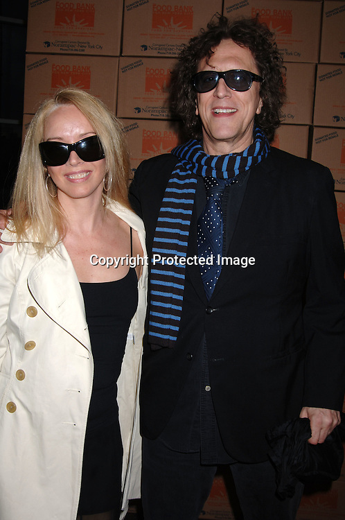 "Patti and Mick Rock ..arriving at The Food Bank for New York City's Annual ' Can..Do"" Awards to help end Hunger in New York City on ..April 25, 2006 at Pier Sixty at Chelsea Piers. ..Robin Platzer, Twin Images"