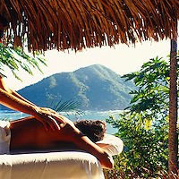 A massage in the shade and with a spectacular view of the Pacific Ocean beyond