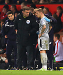 Assistant referee Phil Dowd checks on Kieran Trippier of Burnley following a knock to the head - Manchester United vs. Burnley - Barclay's Premier League - Old Trafford - Manchester - 11/02/2015 Pic Philip Oldham/Sportimage