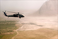 A medevac Blackhawk helicopter flies back to Kandahar Airfield hospital from a hot LZ in the Arghandab valley, carrying a U.S. soldier who had been shot twice in the chest, September 18, 2010.