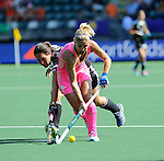 The Hague, Netherlands, June 06: Maike Stoeckel #24 of Germany fights for the ball with Macarena Rodriguez Perez #5 of Argentina during the field hockey group match (Women - Group B) between Germany and Argentina on June 6, 2014 during the World Cup 2014 at Kyocera Stadium in The Hague, Netherlands. Final score 0-3 (0-2) (Photo by Dirk Markgraf / www.265-images.com) *** Local caption ***