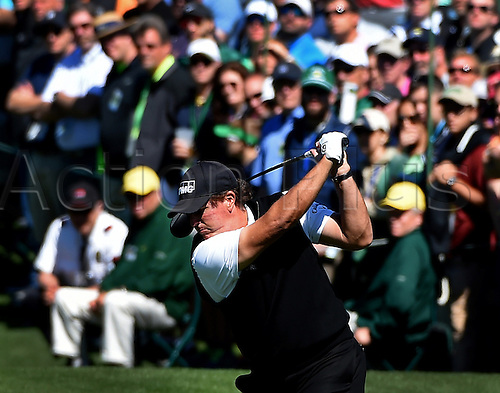 07.04.2016. Augusta, GA, USA. Phil Mickelson follows through on his backswing during the first round of the Masters Golf Tournament on Thursday, April 7, 2016, at Augusta National Golf Club in Augusta, Ga