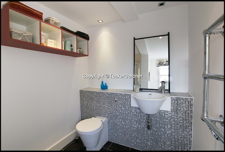 BNPS.co.uk (01202 558833)<br /> Pic: TuckerGardner/BNPS<br /> <br /> One of the bathrooms.<br /> <br /> Potential buyers are scrambling to view a unique RAF control tower that has appeared on the property radar near Saffron Walden in Essex.<br /> <br /> A Second World War tower has been transformed into a stylish family home and is now on the market for £775,000.<br /> <br /> Little Walden airfield in Essex was opened in 1944 and the base was home to American Mustang fighters and B17 Flying Fortresses throughout the war.<br /> <br /> It is now a four-bedroom home with a wrap-around balcony and access to the rooftop to make the most of the panoramic views of the surrounding open countryside.<br /> <br /> Although in its secluded rural location the only flypast your likely to see nowadays is of the feathered variety.