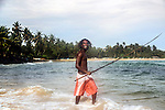Sri Lanka selection<br /> Young man with winning smile fishing on the beach at Mirissa<br /> <br /> Picture by Gavin Rodgers/ Pixel8000<br />  07917221968
