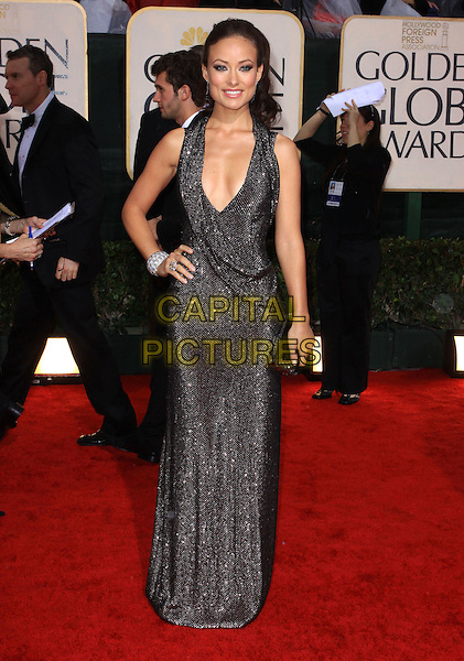 OLIVIA WILDE.67th Golden Globe Awards held Beverly Hilton, Beverly Hills, California, USA..January 17th, 2010.globes full length silver black sparkly chainmail dress sleeveless low cut brown bracelet clutch bag long maxi .CAP/ADM/KB.©Kevan Brooks/Admedia/Capital Pictures