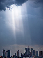 A shaft of Sunlight over the high rise buildings and Manila Skyline, Philippines