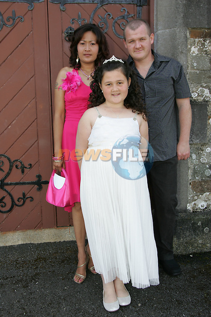 Cherry Dillon with her parents Garret and Meena at her First Communion in Clogherhead on Saturday.