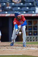 Dalton Pompey (24) of the Buffalo Bison lays down a bunt against the Durham Bulls at Durham Bulls Athletic Park on April 25, 2018 in Allentown, Pennsylvania.  The Bison defeated the Bulls 5-2.  (Brian Westerholt/Four Seam Images)