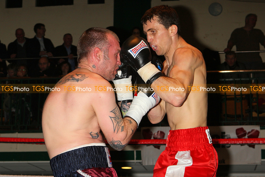 Eddie Corcoran (red shorts) defeats Duncan Cottier in a Welterweight boxing contest at York Hall, Bethnal Green, promoted by Left Jab - 04/03/11 - MANDATORY CREDIT: Gavin Ellis/TGSPHOTO - Self billing applies where appropriate - 0845 094 6026 - contact@tgsphoto.co.uk - NO UNPAID USE.