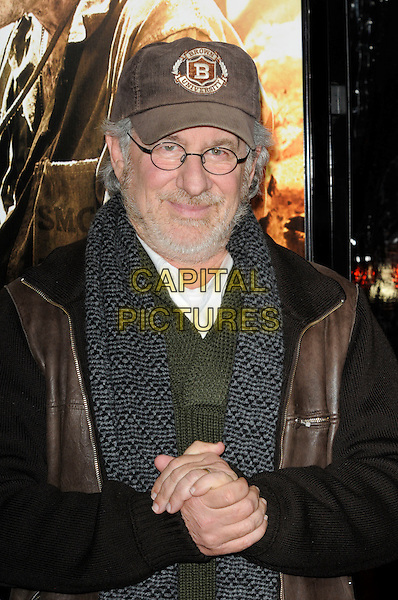 "STEVEN SPEILBERG.at the Los Angeles premiere of HBO's new miniseries event ""The Pacific"" at Grauman's Chinese Theatre in Hollywood, California, USA..February 24th, 2010..half length leather jacket hands glasses cap hat scarf brown grey gray beard facial hair green knitted .CAP/ROT.©Lee Roth/Capital Pictures"