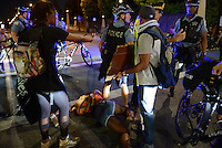 Protesters and police converged and clashed on the intersection of Roosevelt and State Street, briefly shutting down the major West-East artery in the South Loop in Chicago, Illinois on July 9, 2016.  Protests erupted nationwide following the police shootings of Alton Sterling who was selling bootleg DVDs outside a convenience store in Baton Rouge, Louisiana and Philando Castile during a routine traffic stop for a broken tail light in the St. Paul, Minneapolis suburb of Falcon Heights; on Thursday night, a lone gunman Micah Johnson fired and killed five police officers and injured several others during a Black Lives Matter protest in Dallas.