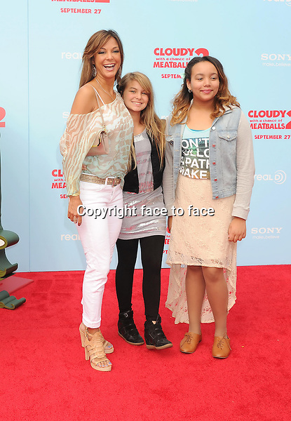WESTWOOD, CA- SEPTEMBER 21: Actress Eva La Rue (L) and children arrive at the Los Angeles premiere of 'Cloudy With A Chance Of Meatballs 2' at the Regency Village Theatre on September 21, 2013 in Westwood, California.(Eva La Rue)<br /> Credit: Mayer/face to face<br /> - No Rights for USA, Canada and France -