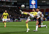 Blackburn Rovers' Charlie Mulgrew clears under pressure from Bolton Wanderers' Josh Magennis<br /> <br /> Photographer Andrew Kearns/CameraSport<br /> <br /> The EFL Sky Bet Championship - Bolton Wanderers v Blackburn Rovers - Saturday 6th October 2018 - University of Bolton Stadium - Bolton<br /> <br /> World Copyright &copy; 2018 CameraSport. All rights reserved. 43 Linden Ave. Countesthorpe. Leicester. England. LE8 5PG - Tel: +44 (0) 116 277 4147 - admin@camerasport.com - www.camerasport.com