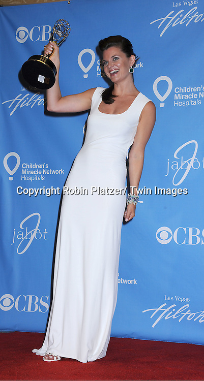 Heather Tom posing in the press room at the 38th Annual Daytime Emmy Awards  on June 19, 2011 at The Las Vegas Hilton in Las Vegas Nevada. ..