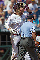 Mississippi State first baseman Wes Rea (35) argues with the home plate umpire Danny Collins after he was called out at the plate during Game 11 of the 2013 Men's College World Series against the Oregon State Beavers on June 21, 2013 at TD Ameritrade Park in Omaha, Nebraska. The Bulldogs defeated the Beavers 4-1, to reach the CWS Final and eliminating Oregon State from the tournament. (Andrew Woolley/Four Seam Images)