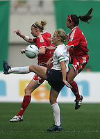Nov 4, 2006: Seoul, South Korea:  USWNT forward (13) Kristine Lilly battles for the ball with Canadian defenders (7) Isabelle Morneau and (3) Melanie Boothwhile playing in the Peace Queen Cup final at Seoul World Cup Stadium. The United States defeated Canada, 1-0.