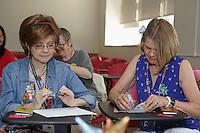 OrigamiUSA 2016 Convention at St. John's University, Queens, New York, USA. Creasers in Patty Grodner's class on Designertasche (Designer Bag) created by von Gabi Vogt.