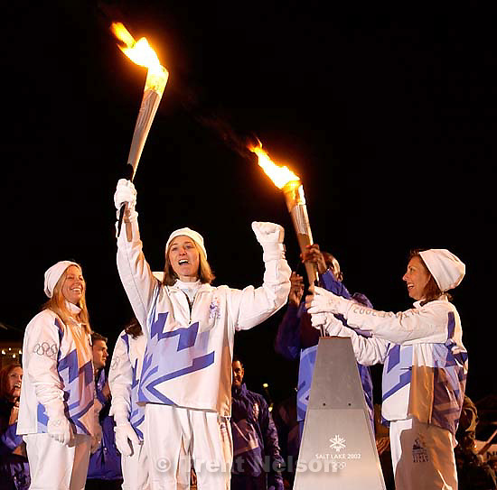The Olympic Torch stops in Philadelphia Saturday night at Independence National Historic Park, site of the Liberty Bell. Four widows of the World Trade Center Attack do a quick torch pass. They are, left to right (in most frames) Fiona Havlish, Debbie Senko, Tara Bane, and Suzanne Berger.&amp;#xA; 12.22.2001, 5:57:21 PM<br />