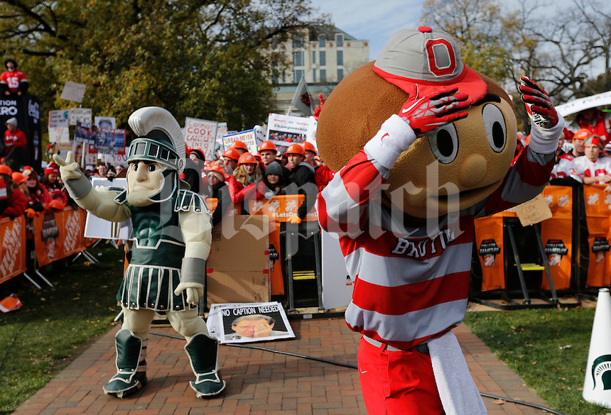Brutus Buckeye and Sparty fire up the fans during ESPN's College GameDay broadcast from the campus of Ohio State prior to the NCAA football game against the Michigan State Spartans in Columbus on Nov. 21, 2015. (Adam Cairns / The Columbus Dispatch)