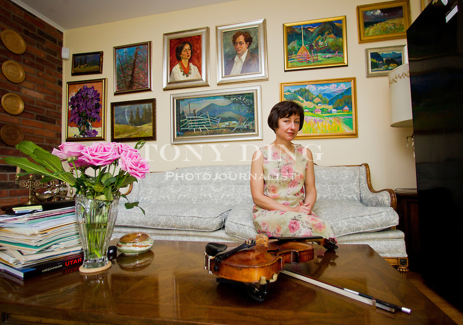 Solomia Soroka, a University of Rochester alumna and Ukrainian-born violinist, poses for a portrait, Wednesday, June 11, 2014, at her home in Ann Arbor, Mich. She's bringing attention to Ukrainian composers, and the quest of Ukrainians to preserve national self-determination in a series of concerts. (AP Photo/Tony Ding)