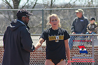 Mizzou assistant track oach Derrick Peterson congratulates freshman Leslie Farmer at the Tom Botts Invitational, Saturday, April 11, 2009 at Audrey Walton Stadium, Columbia, MO.