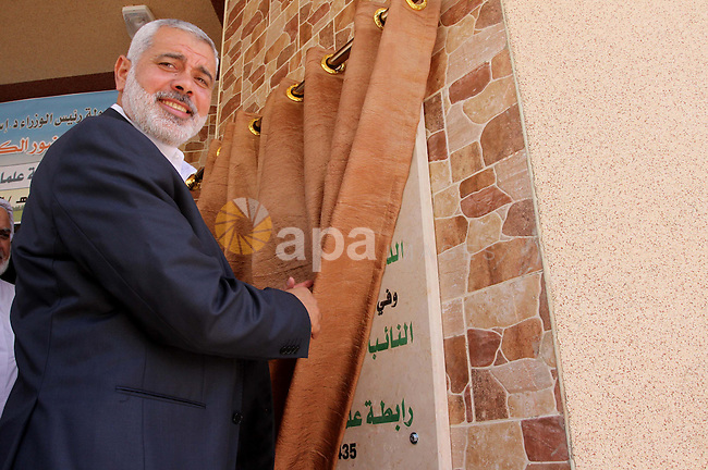 Palestinian Prime Minister in Gaza, Ismail Haniyeh attends the opening of the headquarters of the Palestine Scholars Association in Gaza City, in May 22, 2014. Photo by Mohammed Asad