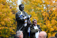 A fan poses for a picture next to the Don Revie statue, outside Elland Road, home of Leeds United<br /> <br /> Photographer Alex Dodd/CameraSport<br /> <br /> The EFL Sky Bet Championship - Leeds United v Birmingham City - Saturday 19th October 2019 - Elland Road - Leeds<br /> <br /> World Copyright © 2019 CameraSport. All rights reserved. 43 Linden Ave. Countesthorpe. Leicester. England. LE8 5PG - Tel: +44 (0) 116 277 4147 - admin@camerasport.com - www.camerasport.com