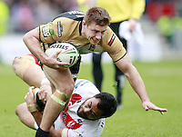 PICTURE BY CHRIS MANGNALL /SWPIX.COM...Rugby League - Super League  - St Helens Saints v Wigan Warriors  - Langtree Park, St Helens, England  - 06/04/12... Wigans Michael McIlorum avoids tackle from St Helens Tony Puletua