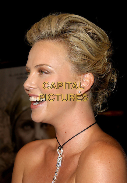 "CHARLIZE THERON .Los Angeles Premiere of ""North Country"" held at The Grauman's Chinese Theatre in Hollywood, California  .October 10th, 2005.RefL DVS.headhsot portrait necklace diamond  laughing profile.www.capitalpictures.com.sales@capitalpictures.com.Supplied By Capital PIctures"