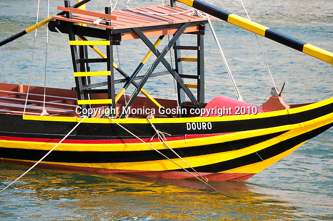 Colorful port wine boat, named Douro, on the Douro River in Porto, Portugal.