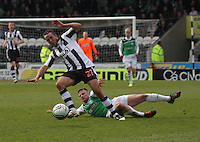 Lewis Stevenson fouls Dougie Imries for his first booking in the St Mirren v Hibernian Clydesdale Bank Scottish Premier League match played at St Mirren Park, Paisley on 29.4.12.