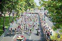 peloton rolls out of Evry for the last stage of the 101th Tour<br /> <br /> 2014 Tour de France<br /> stage 21: Evry - Paris Champs-Elysées (137km)