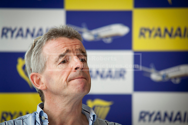 11/10/2011. LONDON, UK. Michael O'Leary, CEO of budget airline Ryanair, talks at a press conference about the launch of his company's new 'Cash Passport' debit card. The card, launched today (11/10/11) aims to allow Ryanair's regular customers to avoid its £6 admin fee when booking flights. Photo credit: Matt Cetti-Roberts